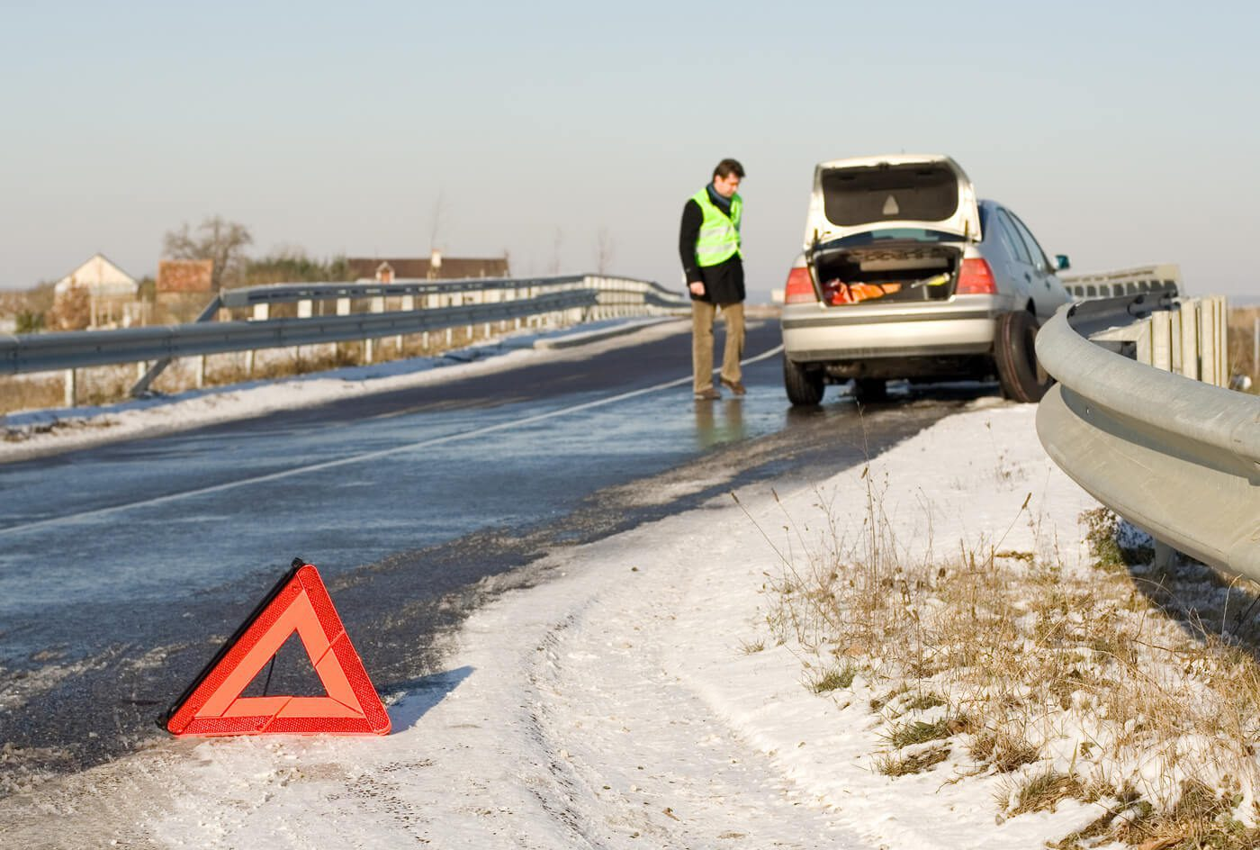 Warning triangle on winter road