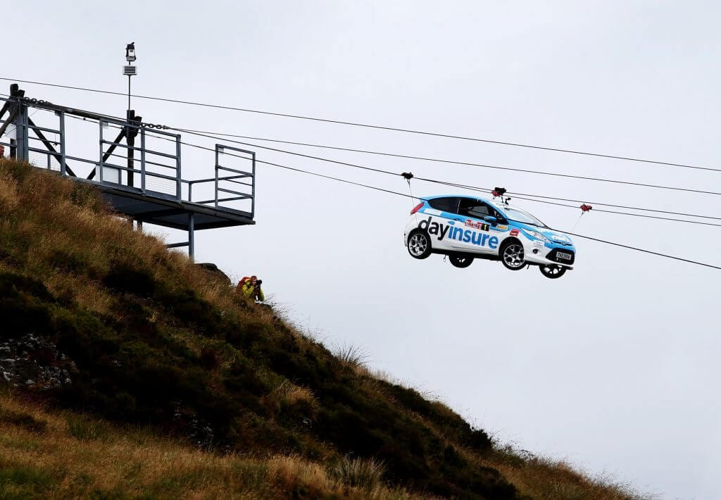 Dayinsure rally car on zipwire