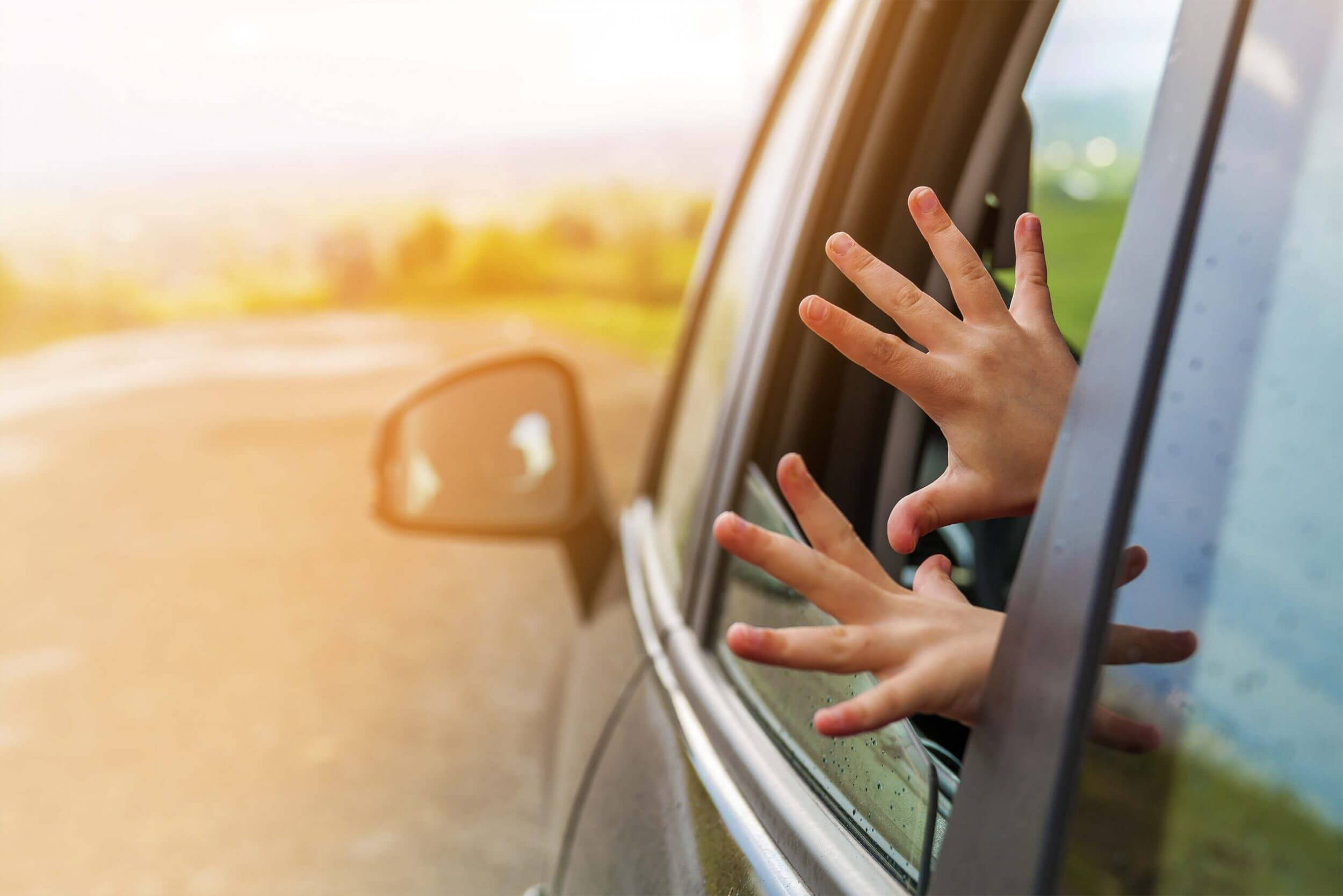 Hands waving out of window