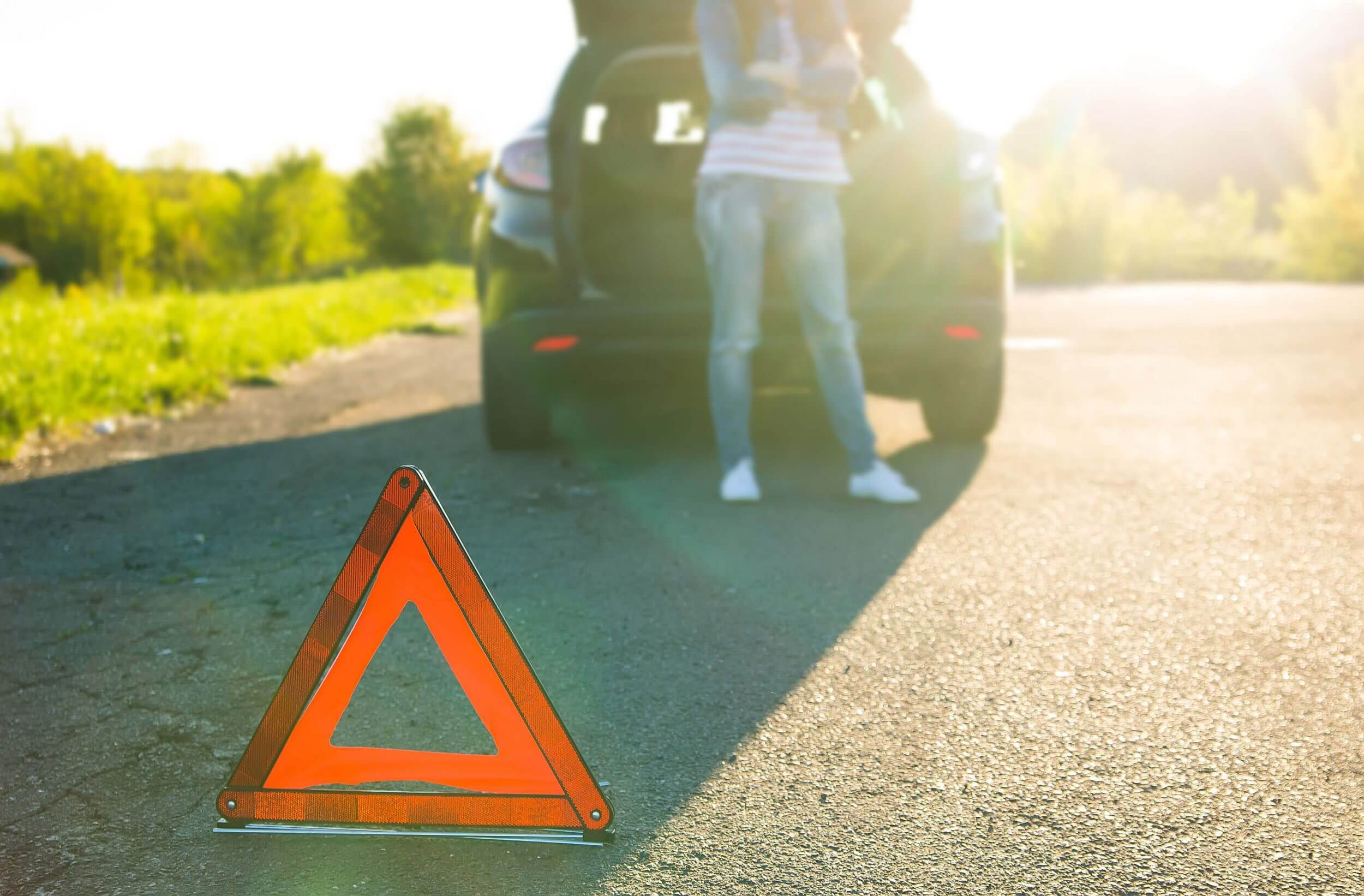 Warning triangle by brokendown car