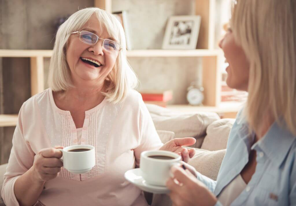 Old woman laughing with her daughter