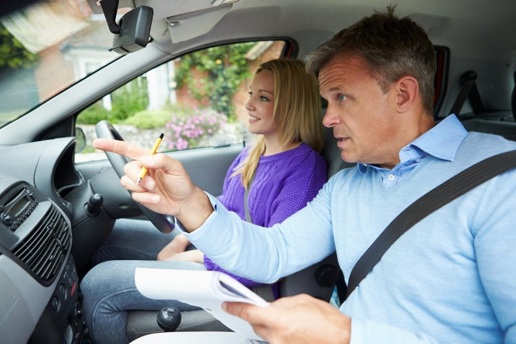 Driving instructor teaching student