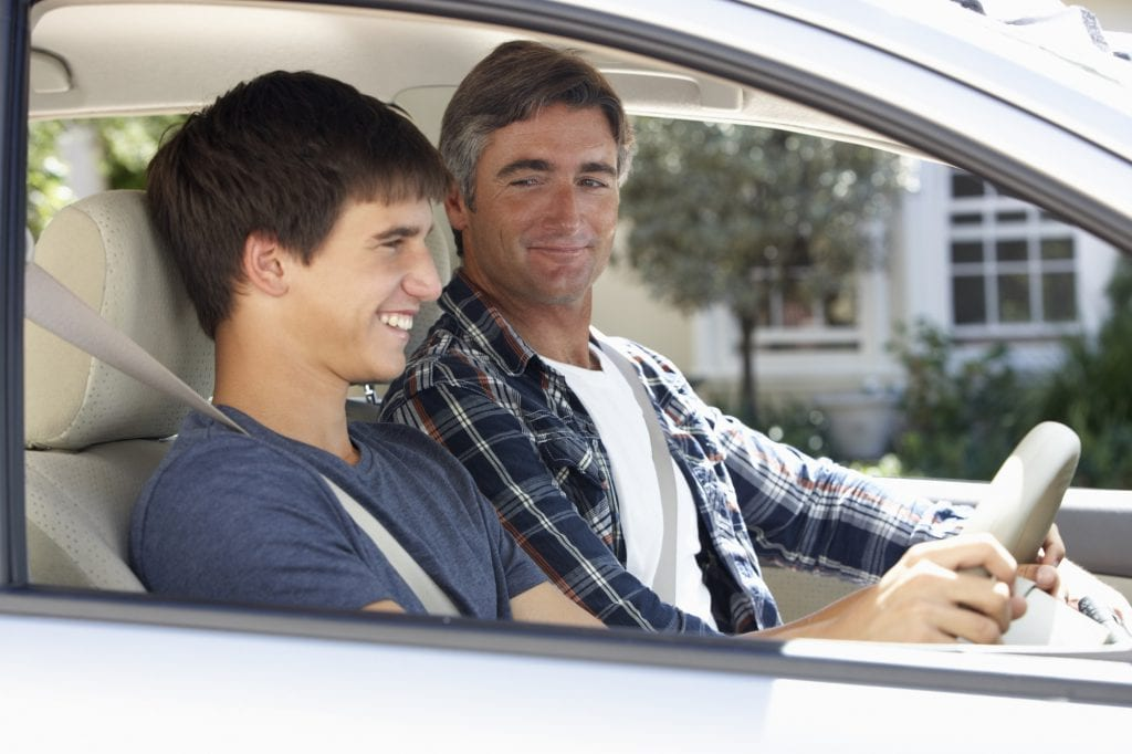 Teen driving with parent