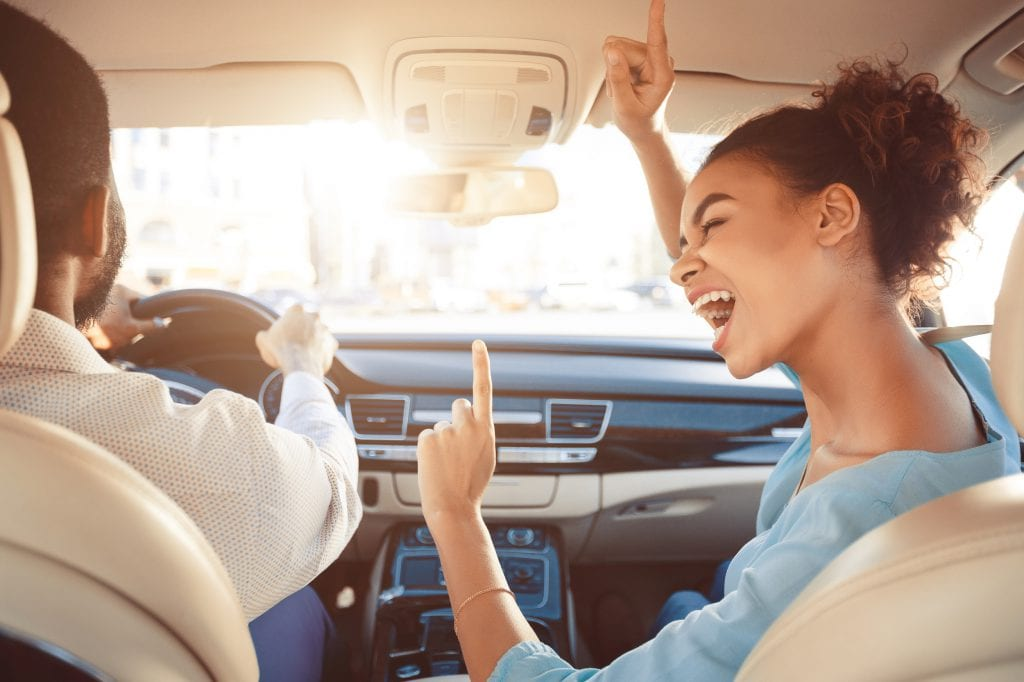 Couple singing to music in the car