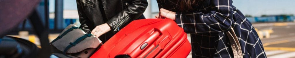 Loading suitcases into car that has temporary car insurance for expats