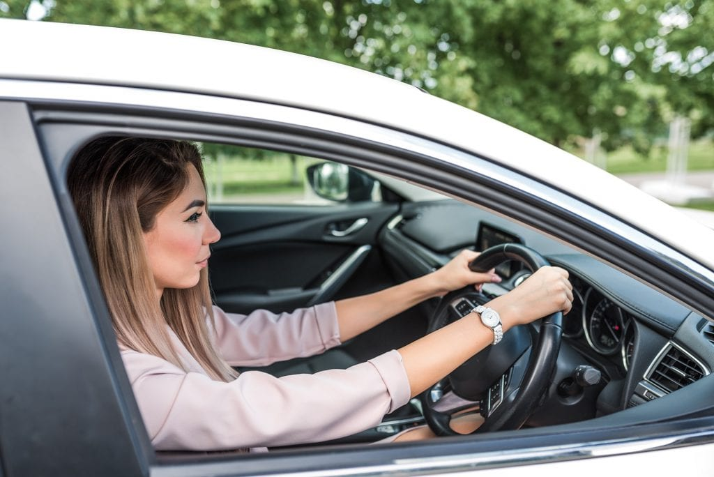 Woman driving car on right handside