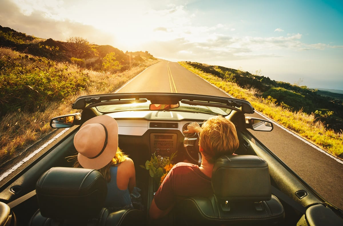 Couple driving on road